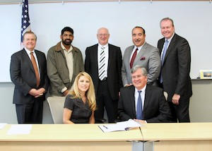 From Left to Right- Row One:(1)Wallace Brithinee, Executive Committee Member of MCIE (2) Shailendra Singh, Executive Committee Member of MCIE (3) Rod Hoover, Vice Chair of MCIE (4) Paul Granillo, President and CEO of IEEP (5) Dan Byrnes, Chairman of the Board of Directors for the Inland Empire Economic Partnership Foundation Row Two: (1) Pearl Virgen, Chair of MCIE (2) George M. Reyes, Chairman of the Board of Directors for IEEP